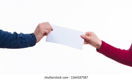 Transfer of correspondence between people.Man hand passes a white envelope to a costumer. Safe Mail delivery concept.