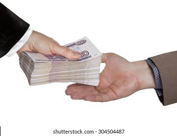 The transfer of money. Male and female hand with a big wad of Russian money.
