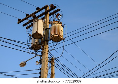 Transformer high voltage power transmission with electricity pylon and beautiful sky background for energy distribution concept