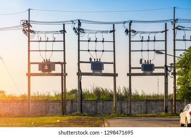 Transformer on high pole.AC high-voltage power transformer on high pole.Transformer and power lines on electric pole.