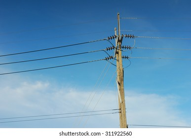 Transformer and power lines on electric pole, High voltage power pole with wires tangle.