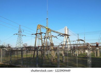 Transformer substation high voltage electrical network. Industrial energy. Metal structures in the open. Insulators and cable.