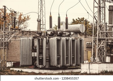 Transformer substation, high-voltage switchgear and equipment. Vintage photo of a power station with poles and wires