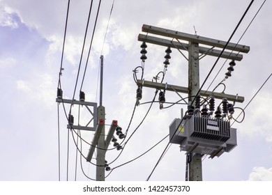 Transformer transmission electricity convert high voltage to low voltage, Power supply transformer reduce voltage, Electricity pole in rural countryside, Distribution Transformer reduction on blue sky