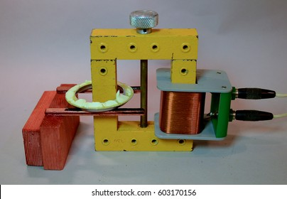 Transformer where the secondary coil is a circular aluminium tray with butter. When the transformer is switched on, the eddy current induced in the tray heats the tray up and the butter melts.