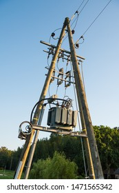 Transformers and high voltage cables on the pole. Three-phase transformers for high voltage transformers into low voltage against blue sky