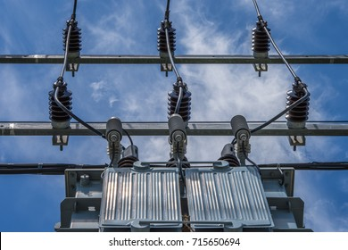 Transformers on a white background for supplying power to the community.