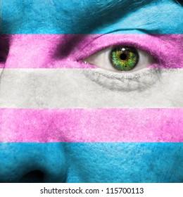 Transgender Flag painted on face  to show Transgender Pride support