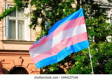 Transgender Pride Flag Blows against building over Pride Parade in Cracov, Poland.
