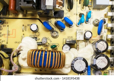 Transistors and capacitors on board. Copper Wire Reel. Microelectronics closeup