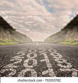 transition between year 2017 and year 2018 painted on asphalt road