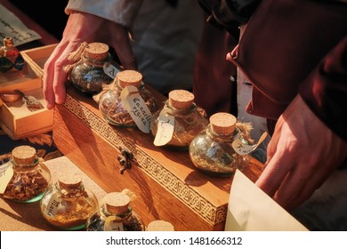 Translate: nutmeg, cinnamon, anise in latin. Trade spices in the medieval market, retro. Fair for the sale of herbs and seasoning. Sale of spices on the market, historical reconstruction.