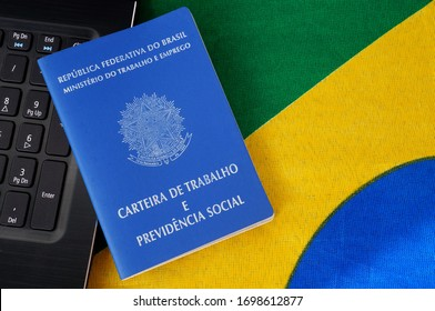Translation: Federative Republic of Brazil, Ministry of Labor./ Brazilian Work Card (Carteira de Trabalho) and laptop computer on top of Brazilian flag. Work at home due to COVID-19. Formal job.