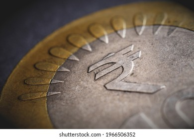 Translation of the inscription: rupee. Fragment of Indian 10 rupee coin with the sign of the national currency. Dramatic illustration with vignetting. Money, economy and banking in India. Macro - Shutterstock ID 1966506352