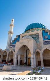 """TRANSLATION: """"Khoja Ahmed Yassawi Mosque"""". Turkestan Khoja Ahmed Yassawi Mosque Picturesque Breathtaking View on a Sunny Blue Sky Day"""