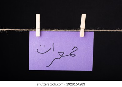 Translation Thursday in urdu word written on a Purple color sticky note hanging with a wire on black background - Shutterstock ID 1928164283