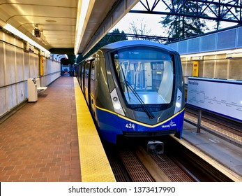 Translink Vancouver SkyTrain.  A Bombardier Innovia Metro 300/Mark 3 train arriving at Nanaimo Skytrain station.  Vancouver/BC/Canada/April 14 2019