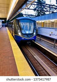 Translink's Vancouver SkyTrain.  A Bombardier Innovia Metro 300/Mark 3 train arriving at Nanaimo Skytrain station.  Vancouver/BC/Canada/April 14 2019