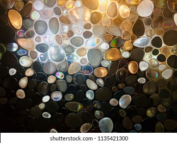 Translucent Background of color glass. Translucent wall of glass stones. Translucent wall of glass pebble.