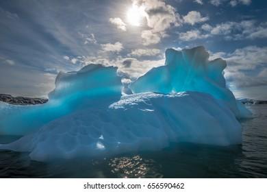Translucent iceberg in Antarctica. Backlight.