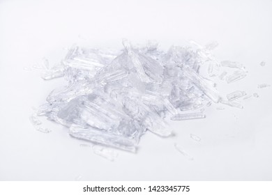 translucent menthol crystals on a white background