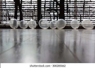 Translucent party balloons on a wooden floor