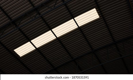Translucent tiles on the roof. Sunlight shines through the translucent roof sheet in bottom view with a copy area. Selective focus