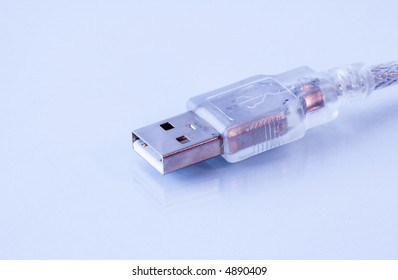 translucent USB connector reflected on glossy background.