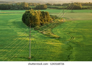Transmission of electricity on the ground. Power lines in the field