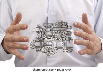 transmission with gears and shafts between the hands of the engineer on the background against the back of stomach Digestive system to the internal organs or process improvement programs trasmissii