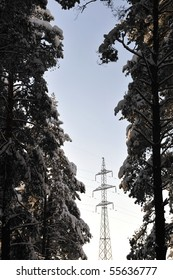 Transmission line tower in the winter forest
