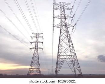 Transmission Power Line pylon tower at sunset