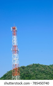 Transmission tower against the blue sky