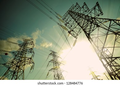 The transmission tower on blue sun sky background