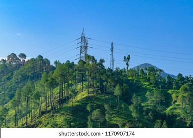 Transmission tower or pylon a steel lattice tower support overhead power line. Electricity transmission in mountain regions through complicated geographic conditions in Himachal Pradesh, India.