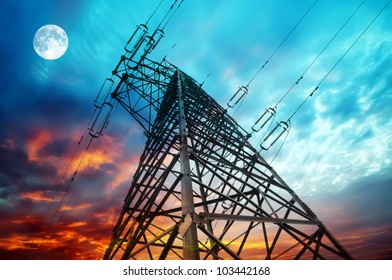 Transmission towers on night background.