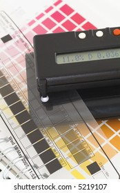 Transmissionsdensitometer with halftone control strip and ColorChecker.