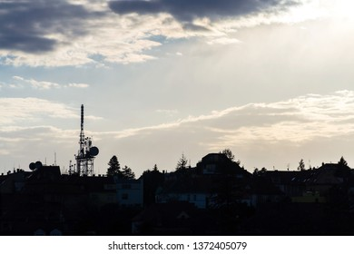 Transmitters and aerials mobile telecommunication tower during beautiful sunset, dramatic cloudy sky with copy space, wireless communication concept