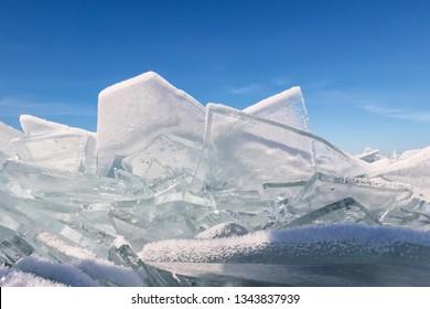 Transparent baikal toros covered with hoarfrost against a blue sky