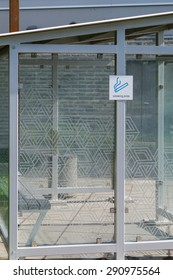 Transparent cabin with sign - smoking area