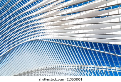 Transparent ceiling in modern railway station with blue sky on a background