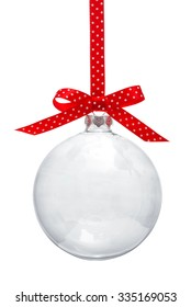 Transparent Christmas ball hanging on red ribbon