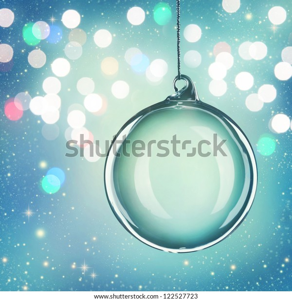 Transparent christmas ball on abstract blue background