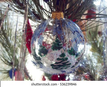 Transparent Christmas ball on Christmas tree
