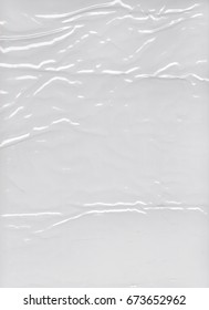 Transparent crumpled plastic packing texture background