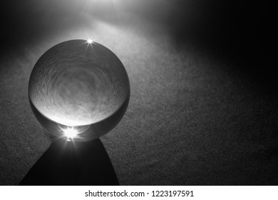 Transparent Crystal ball with black background , close up.