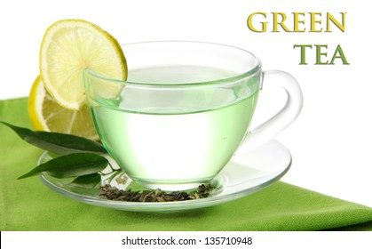 Transparent cup of green tea with lemon on napkin, isolated on white