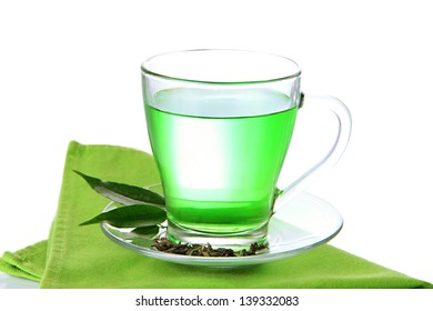 Transparent cup of green tea on napkin, isolated on white