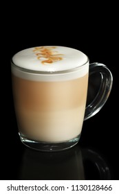 Transparent cup of layered Cappuccino isolated on black