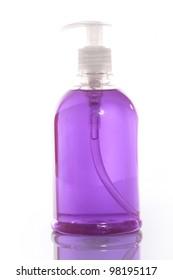 Transparent detergent bottle over white background